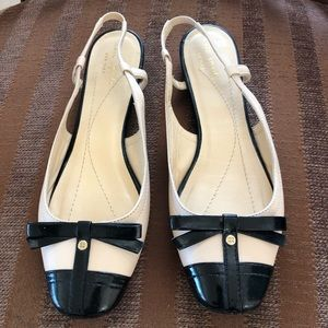 KATE SPADE BEIGE WITH BLACK BOW SHOES.